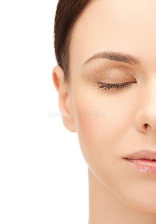 美丽的妇女的半面孔 库存照片