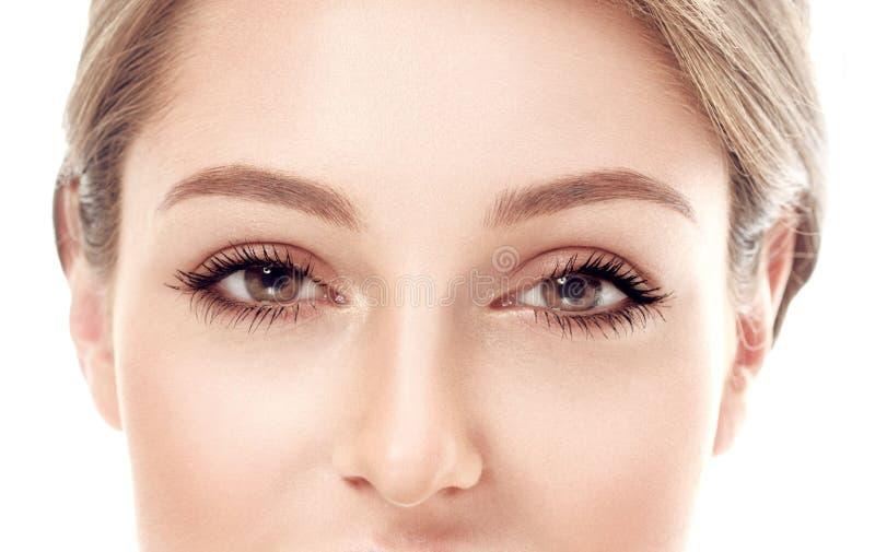 美丽的妇女眼睛和鼻子演播室白色背景的 库存图片