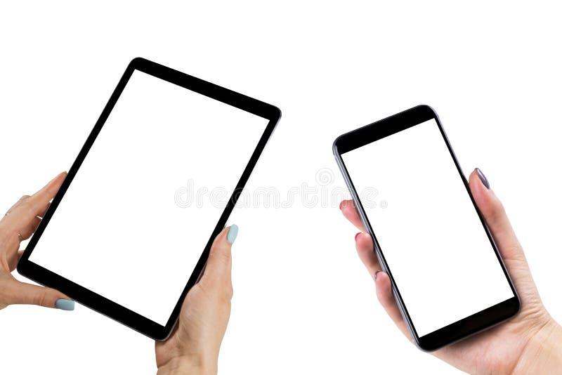 美丽的妇女递拿着套有被隔绝的白色屏幕的巧妙的电话和片剂计算机 有拷贝的企业工作场所 库存照片