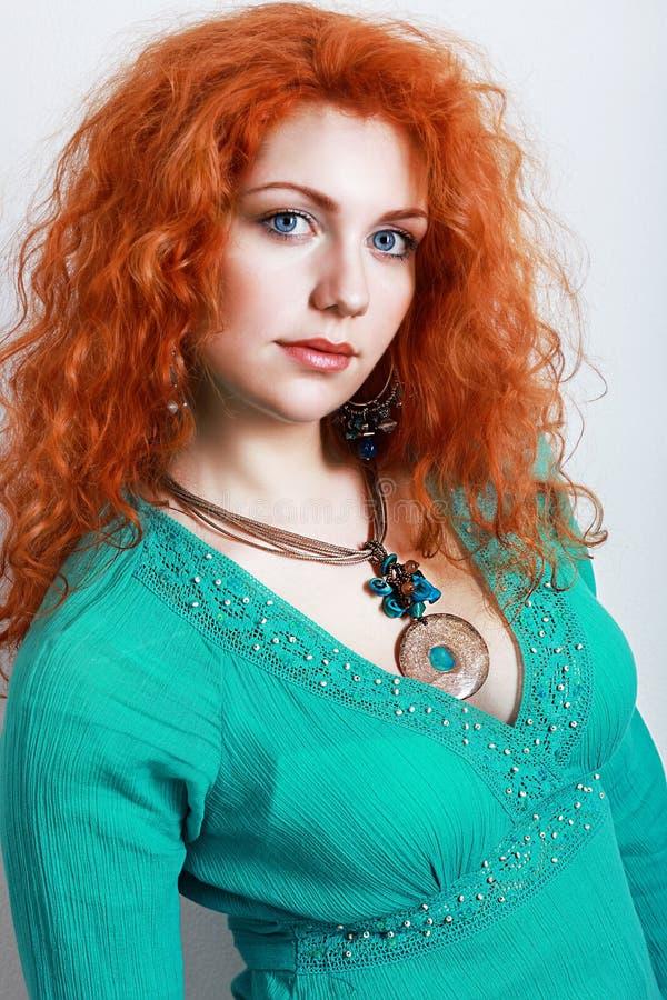 美丽的妇女绿松石礼服 库存图片