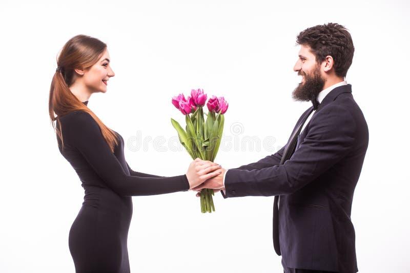 年轻美丽的妇女从他的男朋友得到花桶 图库摄影