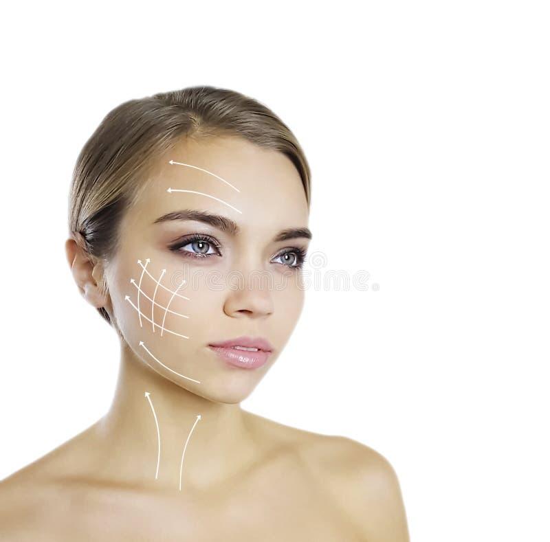 美丽的少女干净的面孔箭头 免版税库存照片