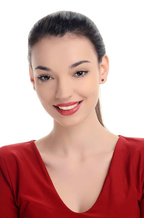 美丽的少妇在与性感红色嘴唇微笑的红色穿戴了。 免版税库存图片
