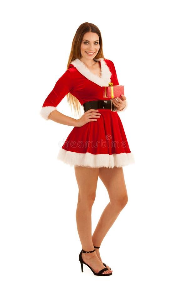 美丽的少妇在圣诞老人礼服煤斗一当前isolat 免版税库存照片