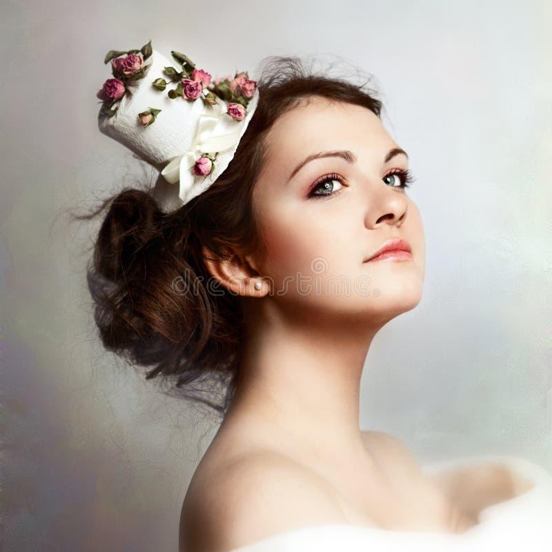 美丽的帽子玫瑰妇女 图库摄影
