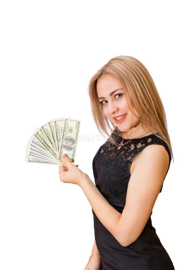 美丽的年轻金发碧眼的女人在手中一百美元票据爱好者和 库存图片