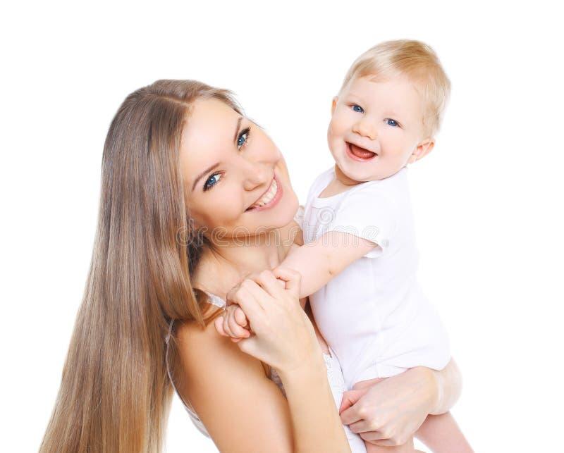 美丽的愉快的母亲和她逗人喜爱的婴孩 免版税库存照片