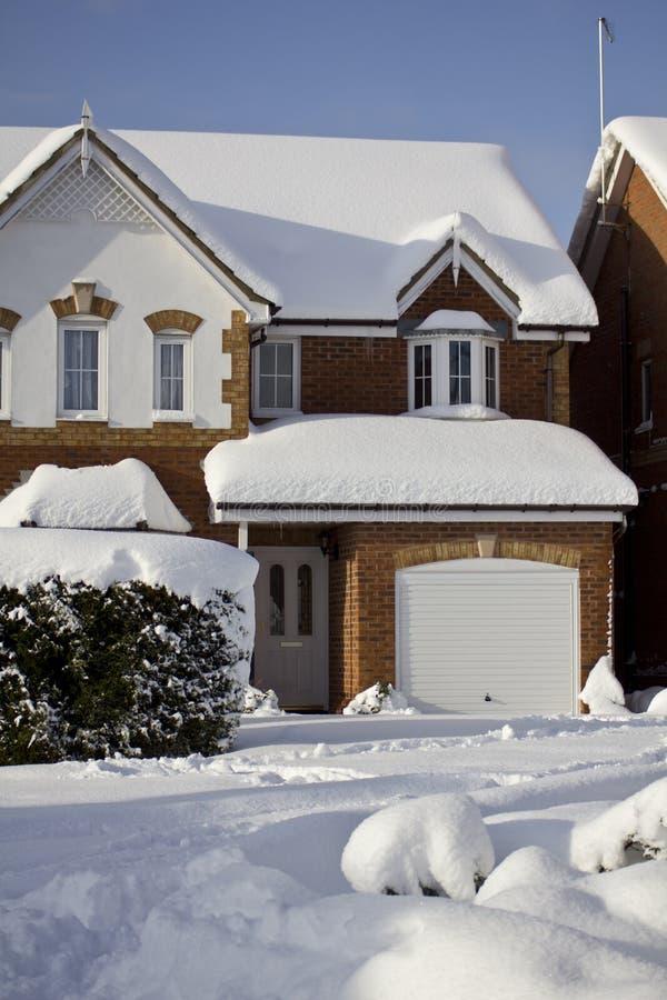 美丽的房子雪 库存图片