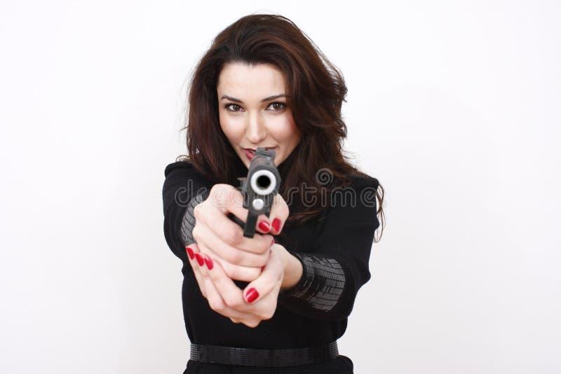 美丽的手枪妇女 库存照片