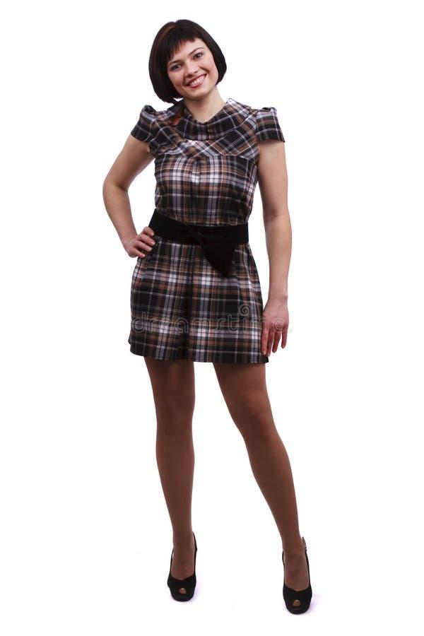 美丽的方格的礼服妇女 免版税库存照片