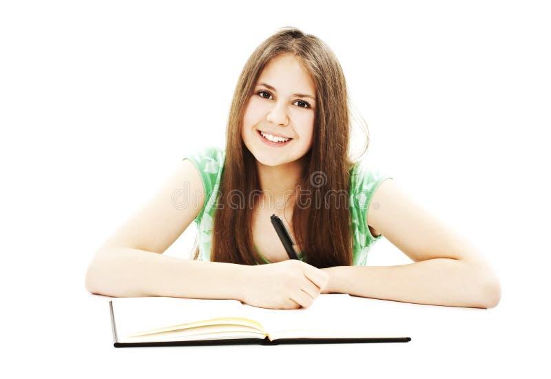 美丽的服务台女孩她的纵向学校 免版税库存图片