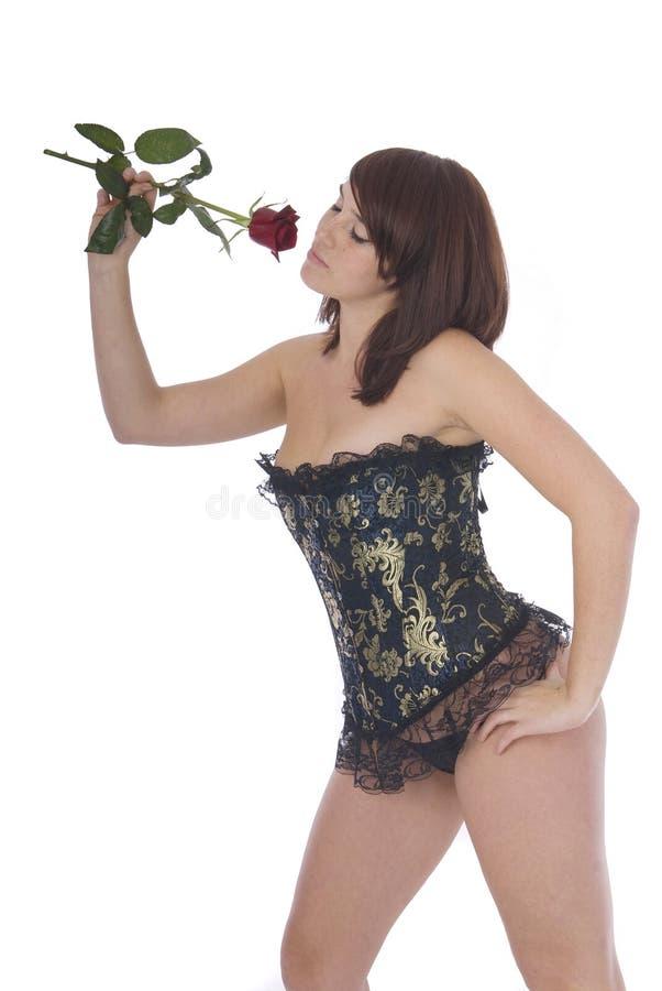 美丽的束腰玫瑰色妇女 免版税库存图片