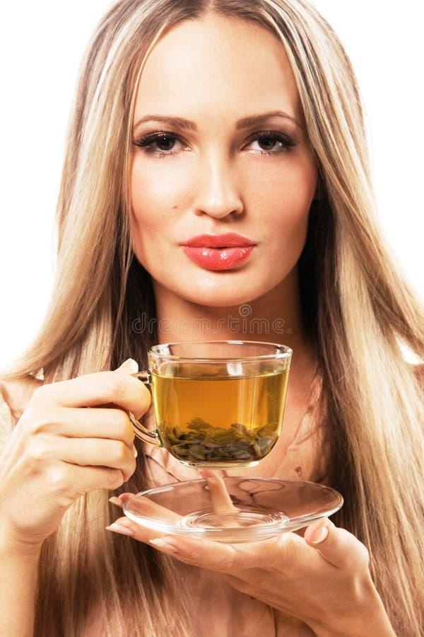 美丽的杯子绿茶妇女 库存图片