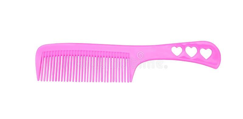 美丽的桃红色妇女头发梳子的关闭有在白色背景、紫色发刷和夹子隔绝的把柄的三个心脏样式的 免版税库存图片
