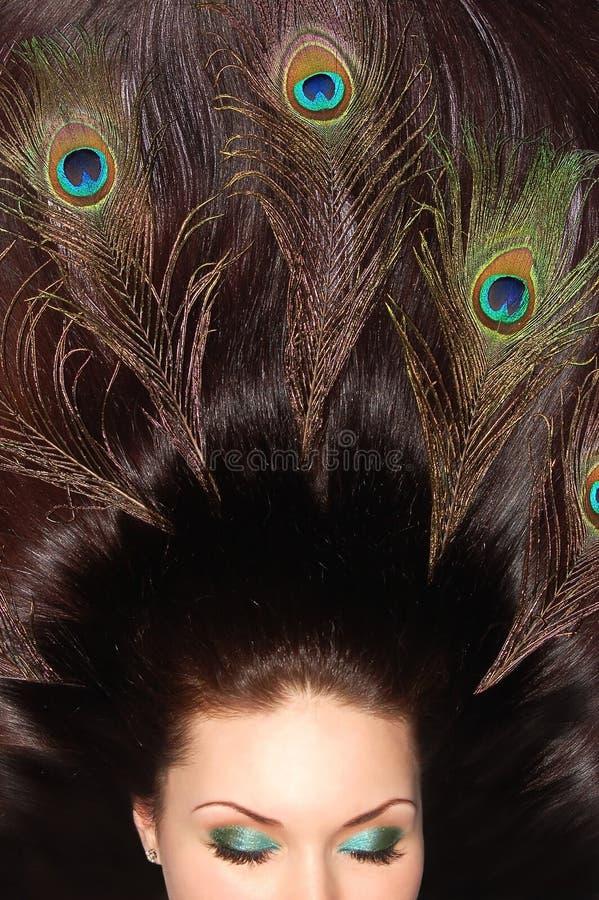 美丽的浅黑肤色的男人装饰了头发长&# 免版税库存照片