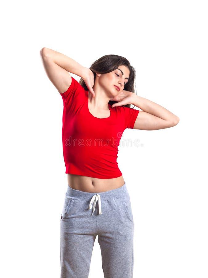 美丽的深色的少年红色衬衣的和体育pantsis的我 库存图片