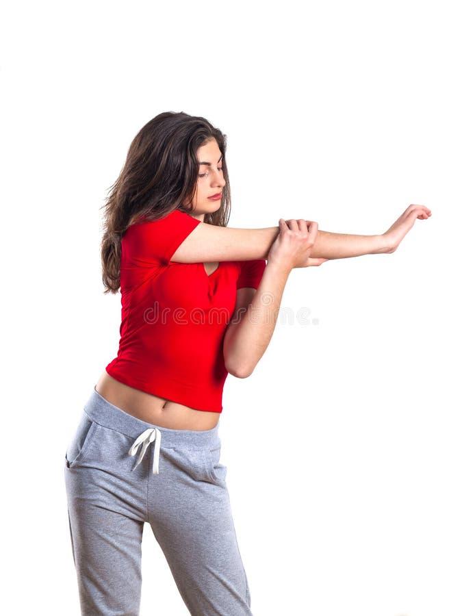 美丽的深色的少年红色衬衣的和体育pantsis的我 图库摄影