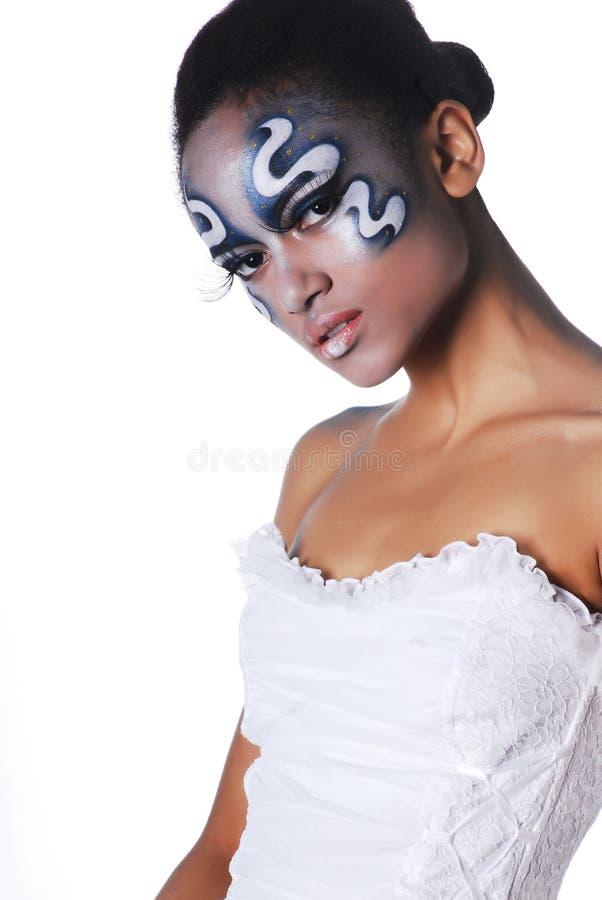 美丽的混血儿女孩画象有人体艺术的在她的面孔 库存照片