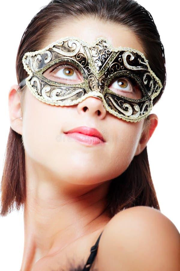 美丽的狂欢节屏蔽妇女年轻人 免版税库存图片