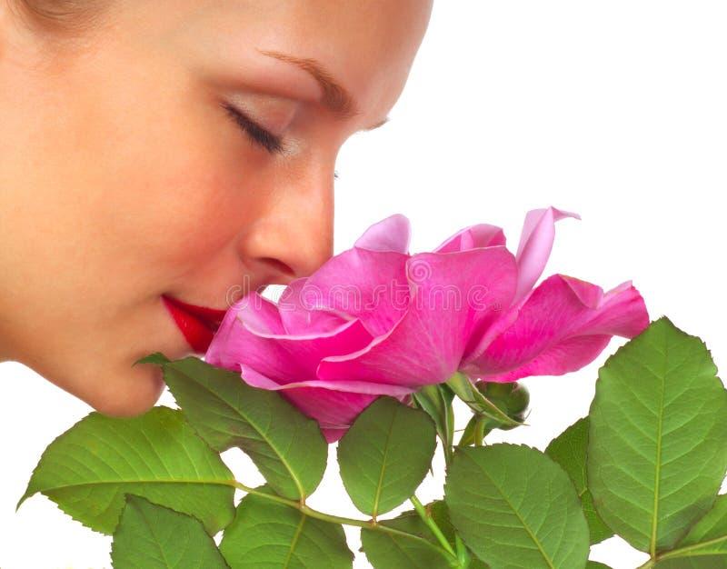 美丽的玫瑰色妇女 免版税库存图片