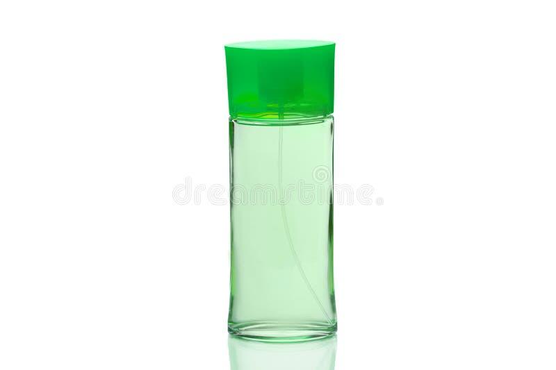 美丽的瓶香水或润肤水 环境友好的women& x27;s化妆用品 绿色世界 白色背景,孤立 免版税库存照片