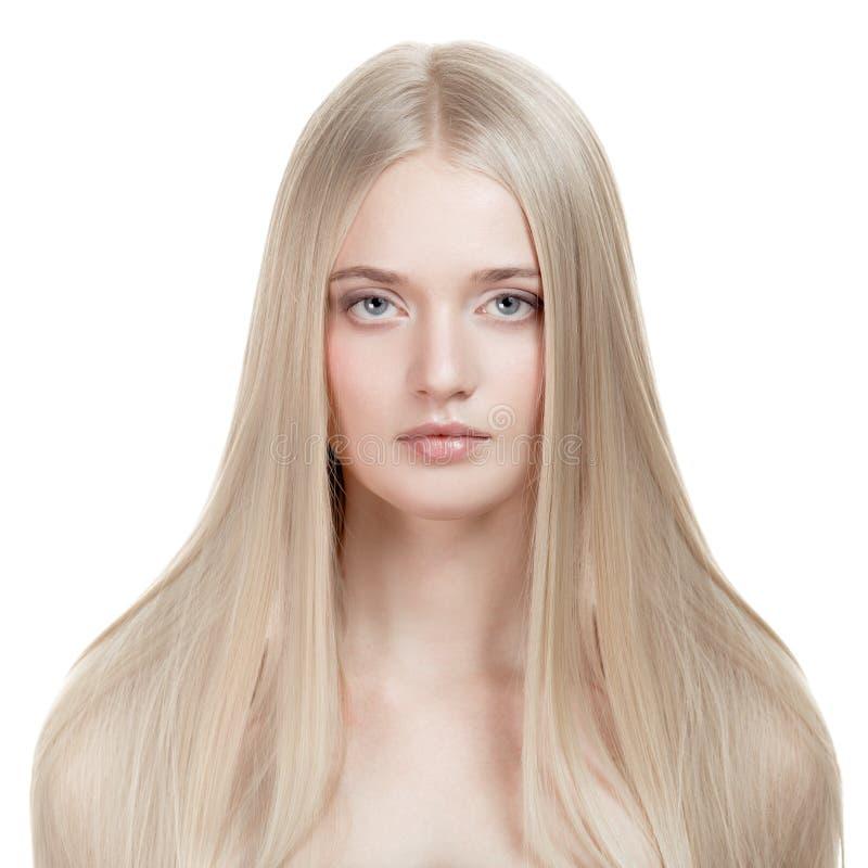 美丽的白肤金发的女孩。健康长的头发 库存图片