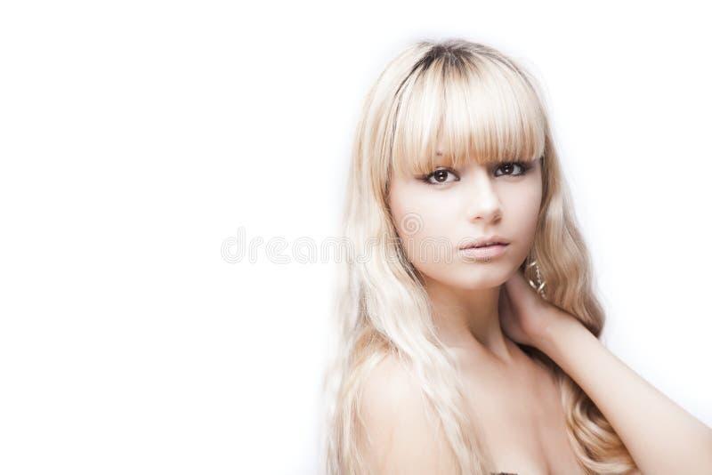 美丽的白肤金发的女孩年轻人 免版税库存图片
