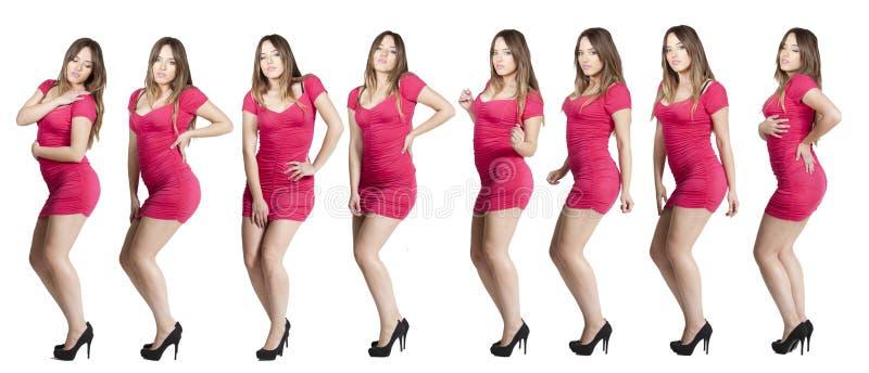 美丽的白肤金发的蓝色跳舞礼服注视粉红色 免版税库存照片