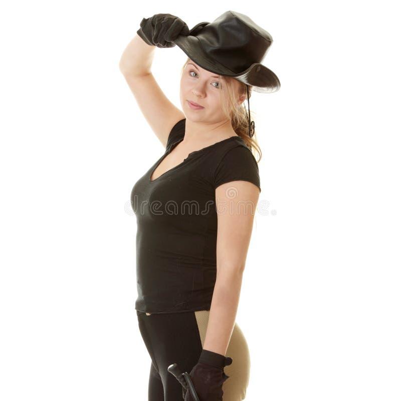 美丽的白肤金发的骑师妇女年轻人 图库摄影