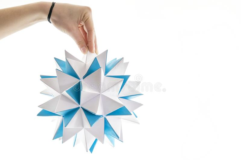 美丽的白色和蓝色origami多角形星 库存图片