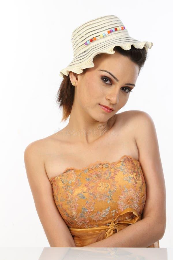 美丽的盖帽服装女孩富有 图库摄影