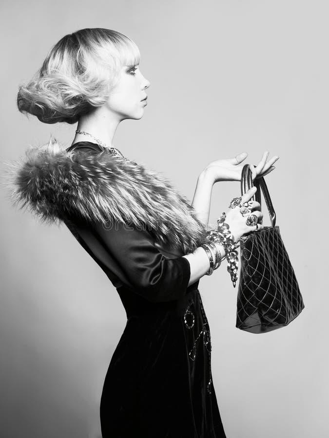 美丽的礼服典雅的夫人年轻人 库存照片
