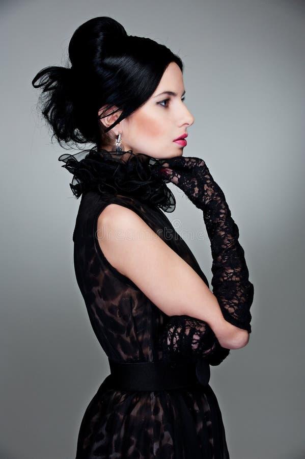 美丽的礼服夜间sideview妇女 免版税图库摄影