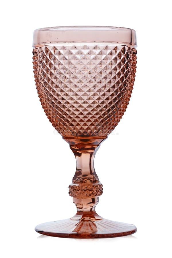 美丽的空的桃红葡萄酒玻璃 玻璃的形状使人想起古板的织地不很细盘 在白色backgro 库存图片
