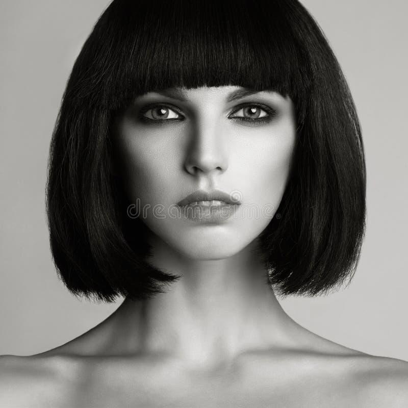 美丽的突然移动理发妇女 库存图片