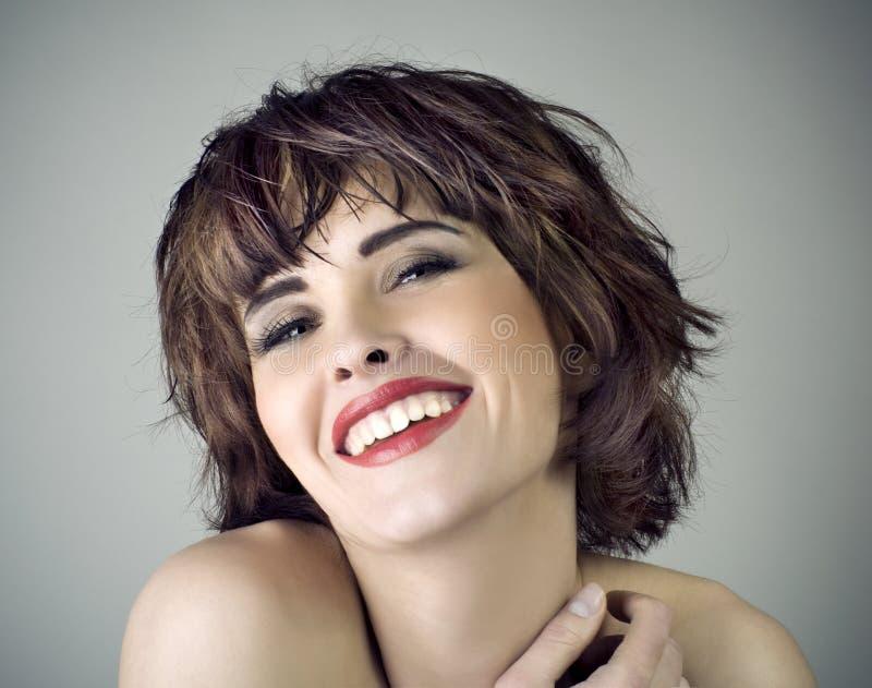 美丽的笑的照片妇女 免版税图库摄影