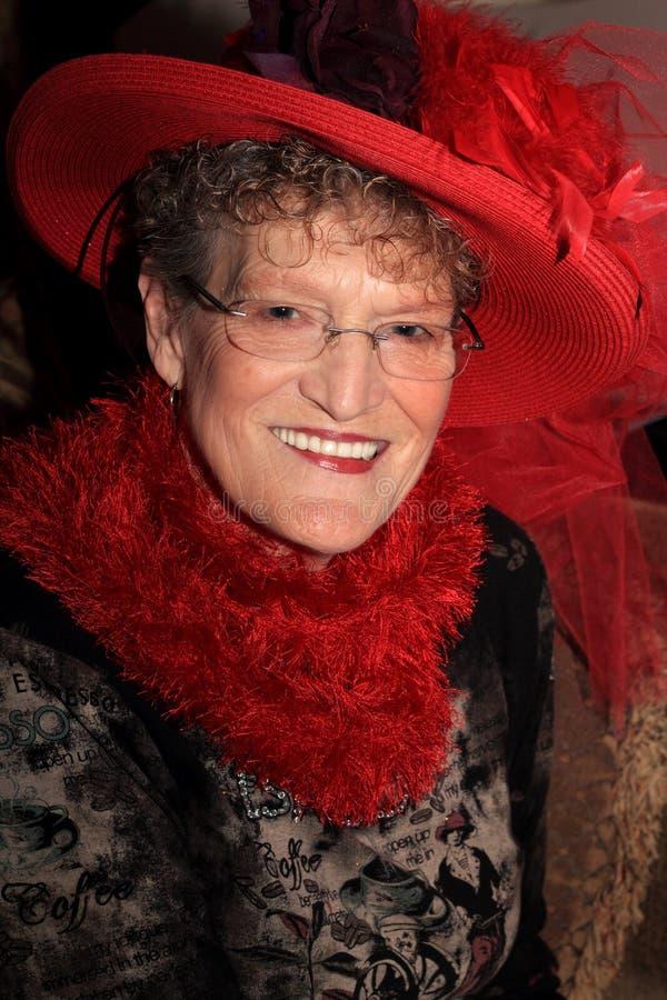 美丽的红色帽子夫人 免版税库存图片