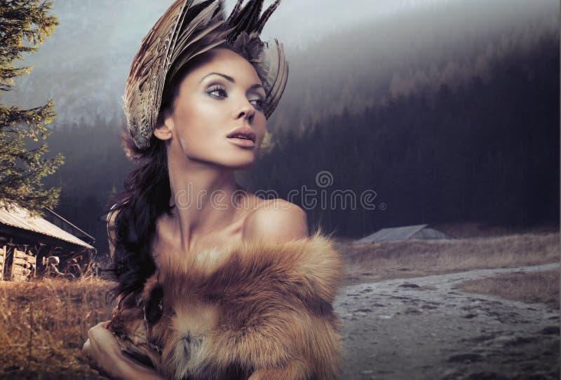 美丽的纵向妇女 图库摄影