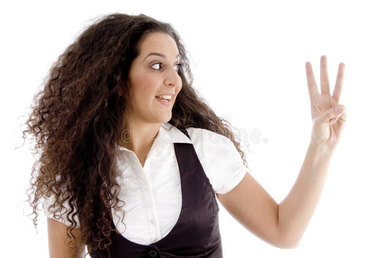 美丽的计数的手指第三妇女 库存照片