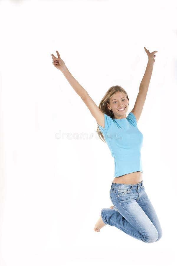 美丽的跳的妇女年轻人 免版税图库摄影
