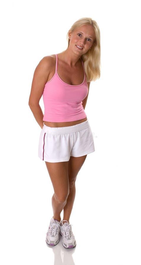 美丽的金发碧眼的女人给健身妇女穿衣 图库摄影