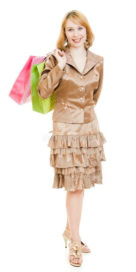 美丽的金子购物诉讼妇女 库存照片
