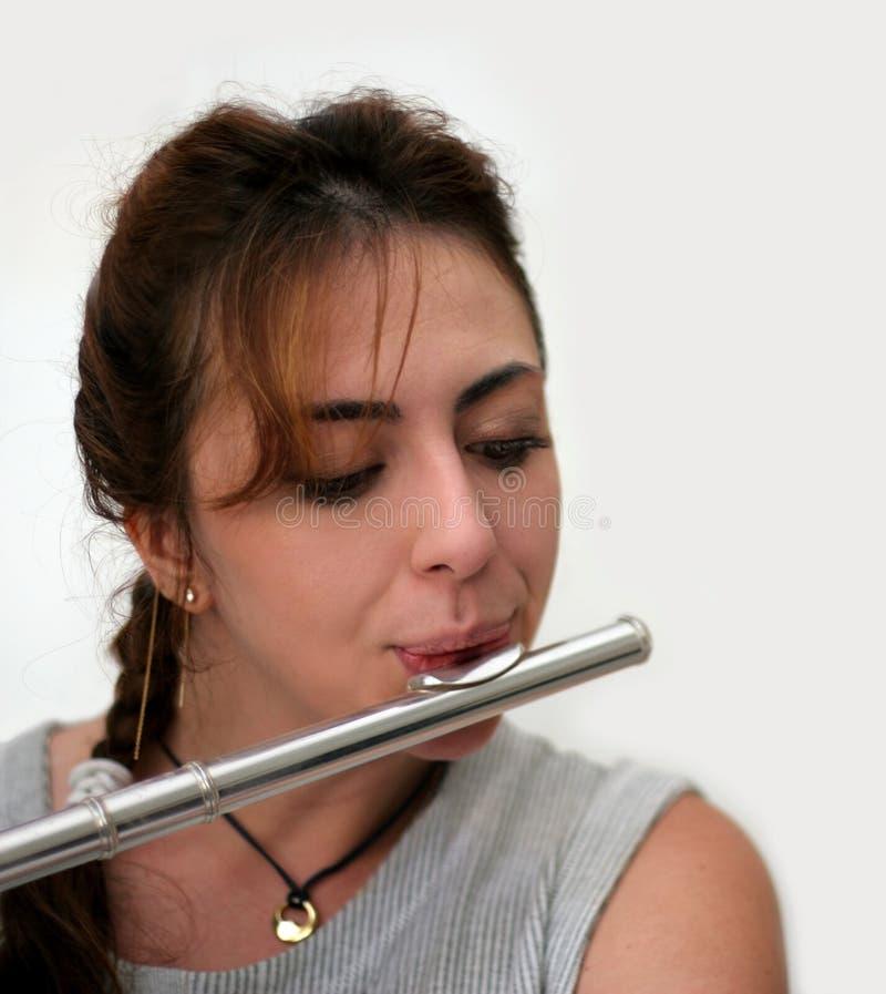美丽的长笛演奏家 图库摄影