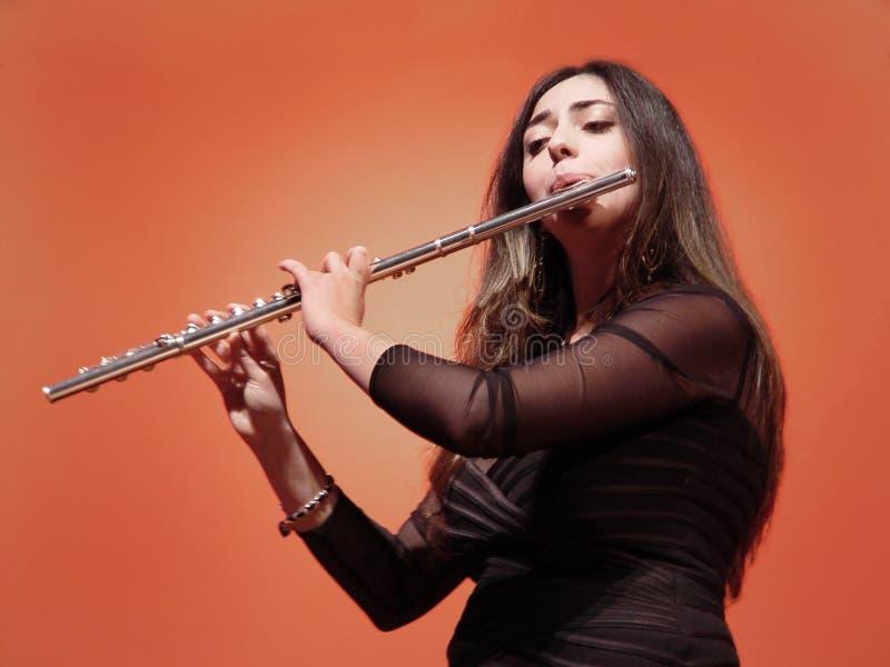 美丽的长笛演奏家 库存照片