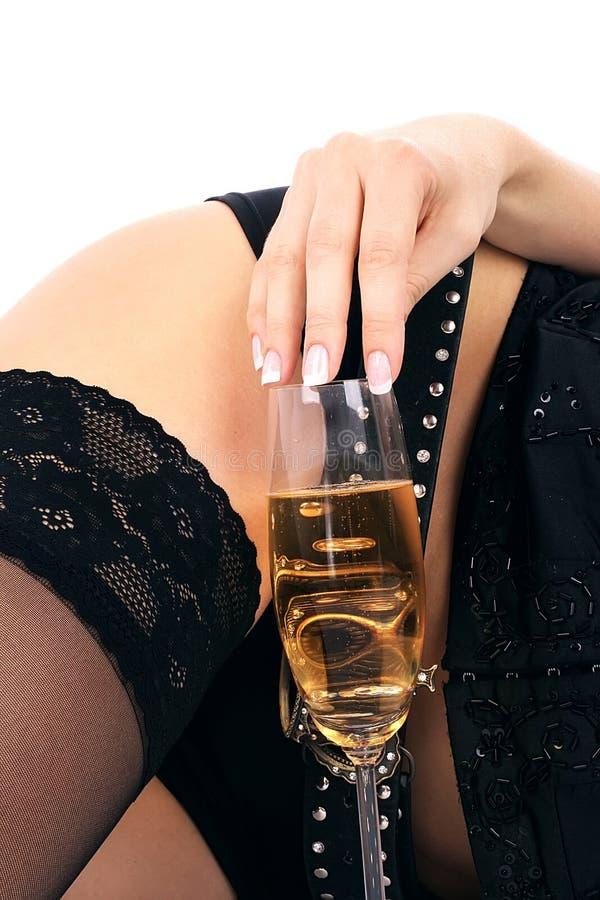 美丽的香槟玻璃臀部 免版税图库摄影