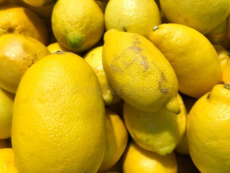 美丽的黄色,橙色自然甜酸维生素可口成熟椭圆形明亮的柠檬,果子,柑橘 纹理,背景 库存图片
