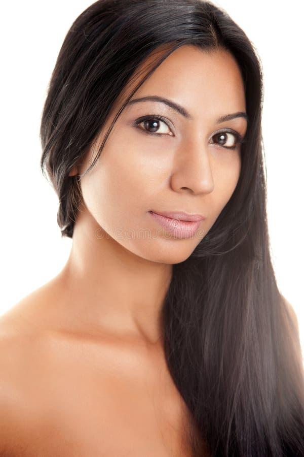 美丽的黑发长的东方妇女 图库摄影