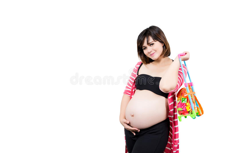 美丽的9个月孕妇的画象有举行的 库存照片