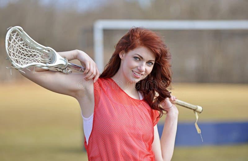 美丽的年轻女性曲棍网兜球球员 库存图片
