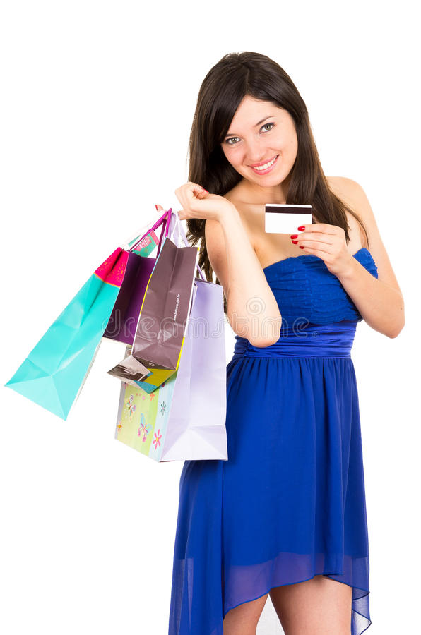 美丽的年轻浅黑肤色的男人微笑的妇女购物 免版税库存图片